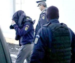 politist prins cu focuri de arma